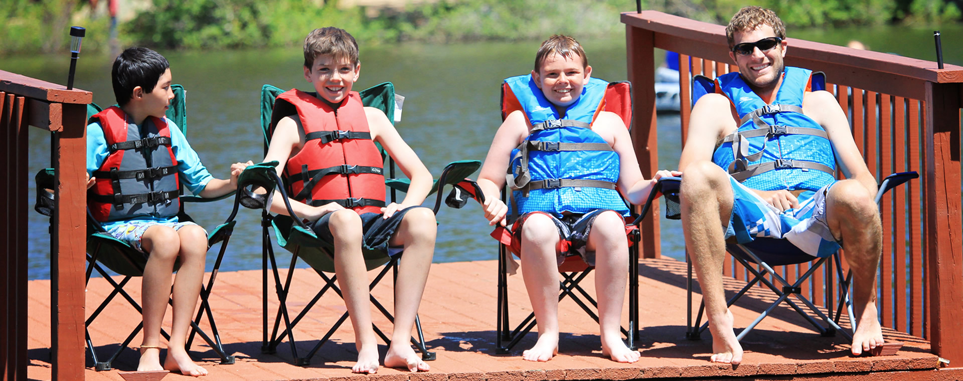 Kids sitting on a dock